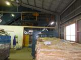 元自動車ディーラー営業所の建物に再生ベーラーを設置